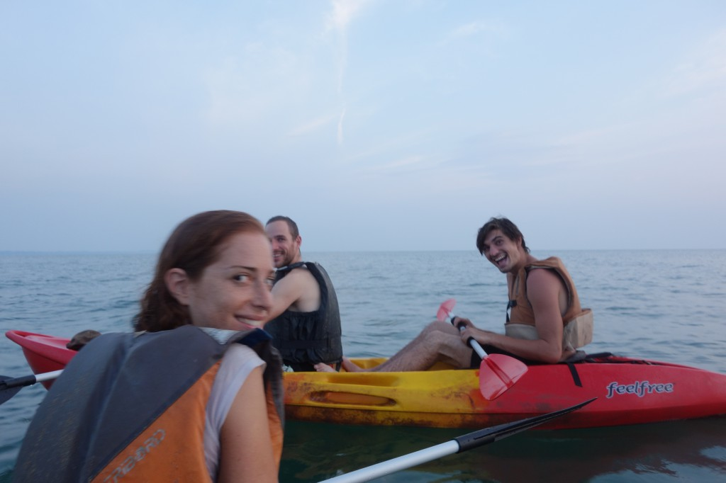 Kayaking next to dolphins you can't see but are definitely there